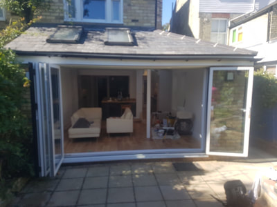 Kitchen extension in Cambridge finished with beautiful bi fold doors